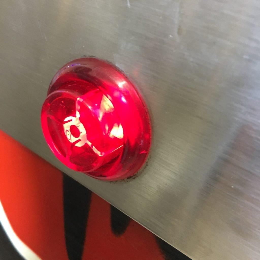 Red incandescent flipper button